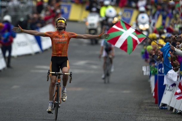 A fan waves a Basque flag as Spain's Sam
